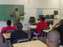 Man speaking to students in a classroom